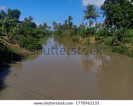 a river that has murky water during the rainy season