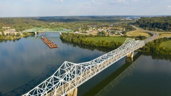 A river Tugboat pushes barge contents down the Ohio River south of Henderson West Virginia