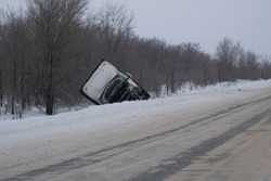 A road accident involving a van in very difficult winter conditions. Part of the image is blurred.