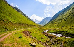 A road among green mountains and hills. Green mountain canyon landscape. Green mountain hills. Mountain landscape