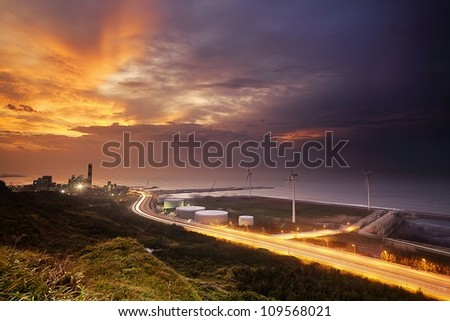 A road and windmills during sunset, made with a wide angle lens