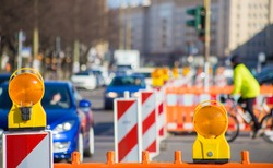 A road construction hinders traffic in a city