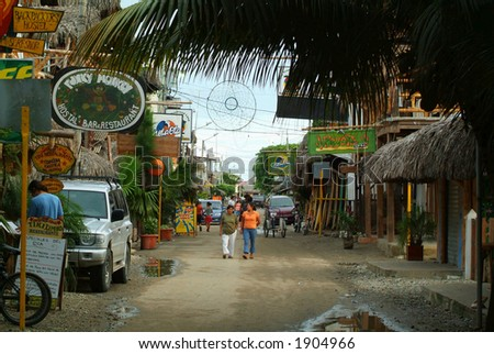 A road in a tropical town on the coast (South America)