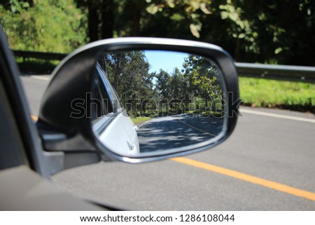 a road reflection in car's mirror background #1286108044