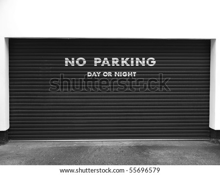 A road sign for a no parking area