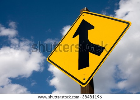 A road sign offering direction.