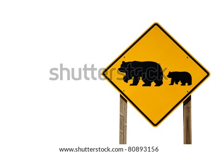A road sign provides a warning about grizzly bears near the freeway.