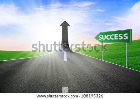 A road turning into an arrow rising upward with a road sign of success, symbolizing the direction to success - stock photo