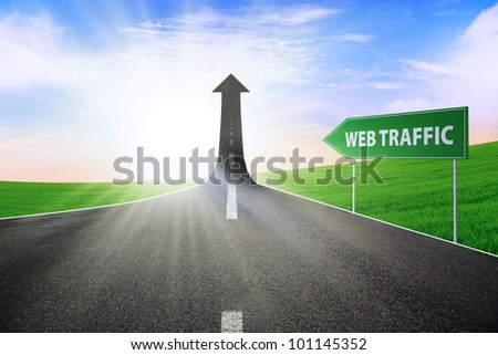A road turning into an arrow rising upward with a road sign of web traffic, symbolizing the way to improve web traffic