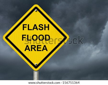 A road warning sign against a stormy sky with words Flash Flood Area, Flood Warning Stock photo ©