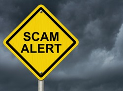 A road warning sign against a stormy sky with words Scam Alert, Warning of Scam