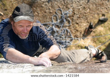 A rock climber with a determined expression.