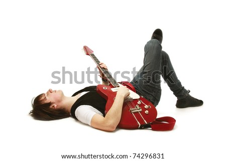 A rock guitarist lying on the floor