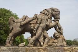 A rock sculpture of horse crushing a soldier during war at Sun Temple, Konark, Orissa, India
