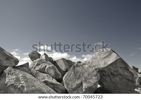 A rock wall against a blue sky. stock photo