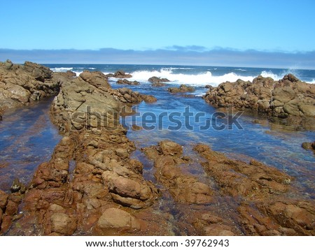 A rocky coast in Perth with high energy waves constantly crashing on it.