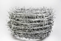 A roll of barbed wire over white background