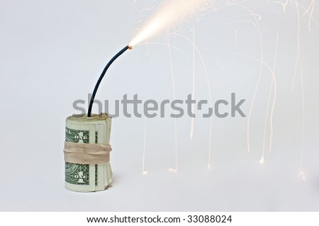 A roll of dollar bills attached to a burning fuse on a white background, resembling a bomb made out of dollar bills (http://www.artistovision.com/metaphors/dollar-bomb-white-bg-closeup.html).
