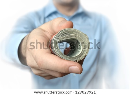 A roll of dollars in a hand