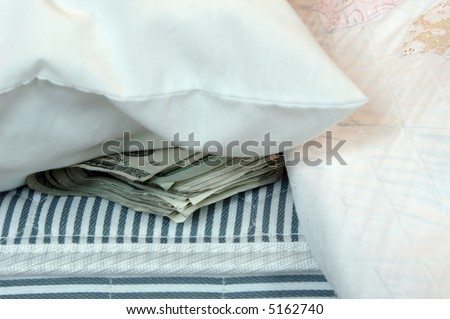A roll of money tucked in a mattress for safekeeping.
