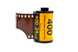 A roll of Photographic film on a white background.