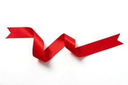 A roll red ribbon isolated on white background