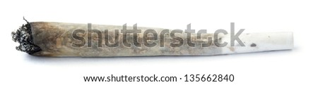 A rolled marijuana joint half burnt, isolated on white.
