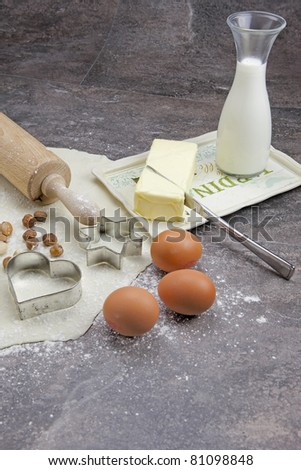 a rolled out dough to bake biscuits with different ingredients