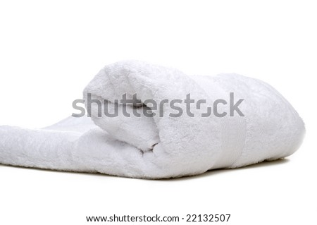 A rolled up white towel on a white background