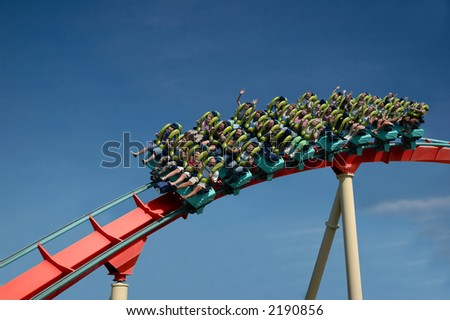 A roller coaster ride at a theme park - stock photo