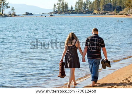A romantic image of a young couple at Lake Tahoe.