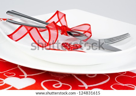 A romantic table setting with hearts and ribbon