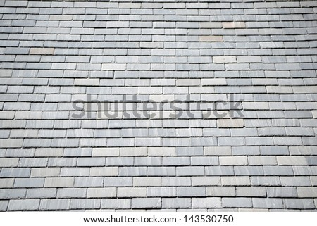 A rooftop covered with gray slate shingles
