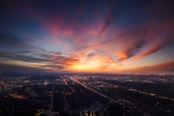 A rooftop view of a gorgeous sky over city lights