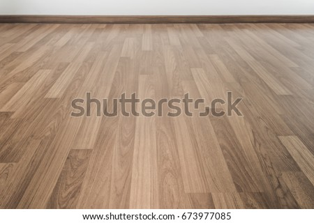 A room with pale wood parquet floor. #673977085