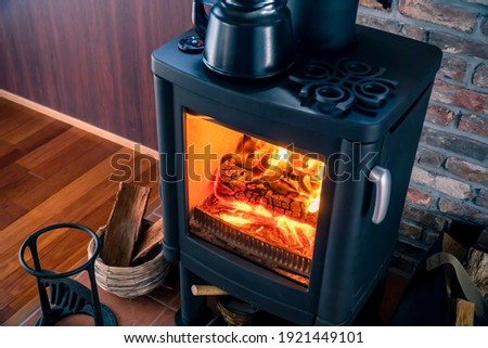 A room with Wood-burning stove. Foto d'archivio ©