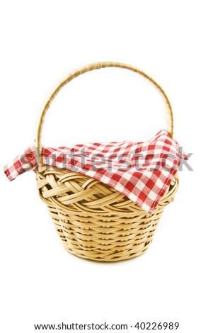 A rotan Picnic-basket with a table-cloth isolated on a white  background