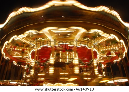 "A rotating Merry-go-round at the famous ""Weihnachtsmarkt"" (The Christmas Market) of Frankfurt, German, Europe"
