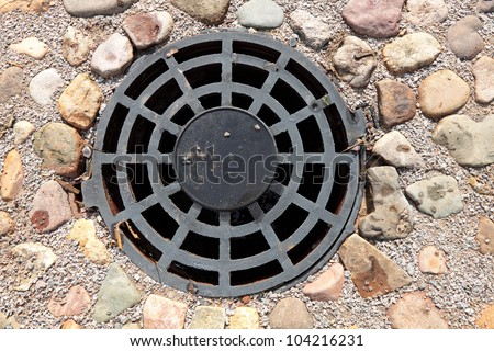 A round grille sewage wells to drain rain and melt water