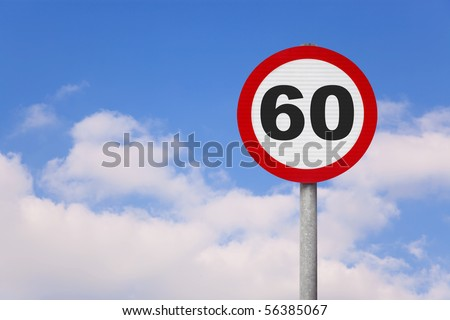 A round roadsign with the number 60 on it against a blue cloudy sky.