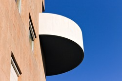 A rounded balcony in a modern building (Pesaro, Italy, Europe)