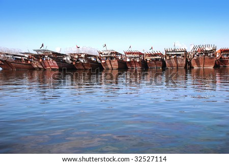 A row of arabic traditional, wooden boats.