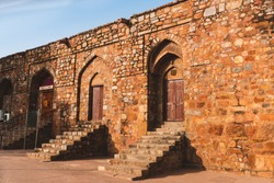 A row of arched doorways with staircase at a famous old fort monument in Delhi, India. Also known as Purana Qila or Quila.