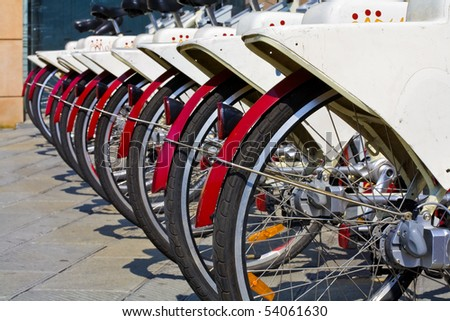 a row of bikes for rent for an eco friendly tourism in genoa, italy