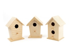 a row of bird houses representing the real estate market isolated on white