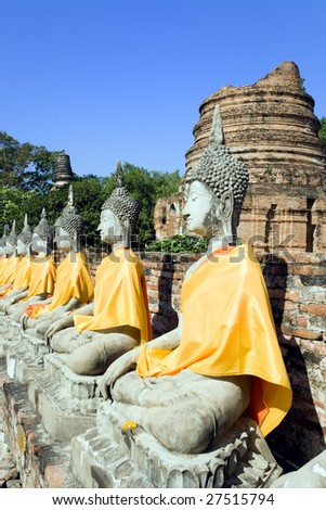 A row of Buddha statues at the temple of Wat Yai Chai Mongkol in Ayutthaya near Bangkok, Thailand.