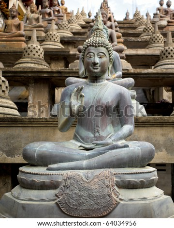 A row of Buddhas and Stupas. - stock photo