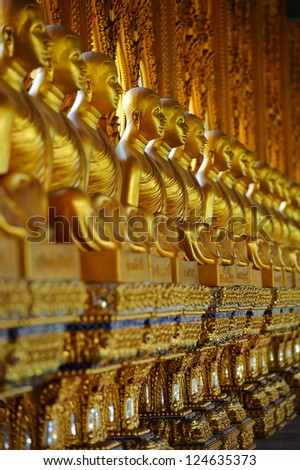 A row of buddhas in Bangkok, Thailand.