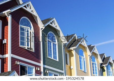 A row of colorful new townhouses or condominiums.