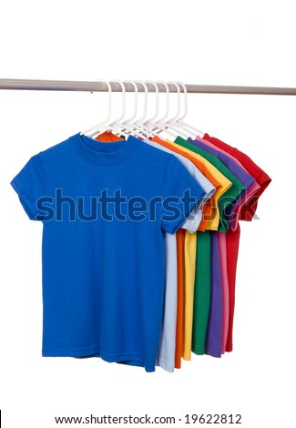 A row of colorful row t-shirts hanging on hangers on a white background - stock photo